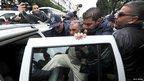 Algerian police arrest a demonstrator in Algiers