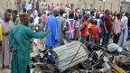 People look at the damages after two explosions targeting a busy market in Nigeria's north-eastern city of Maiduguri left at least 50 people dead.