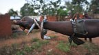 """A member of the """"anti-balaka"""" Christian militia shows his charm bracelets in Boali, near Bangui, the capital of the Central African Republic"""