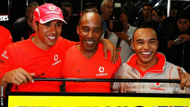Lewis Hamilton with his father and brother