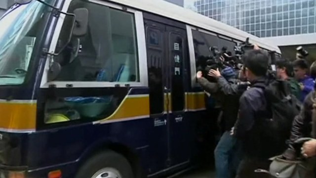Carson Yeung being driven away from court
