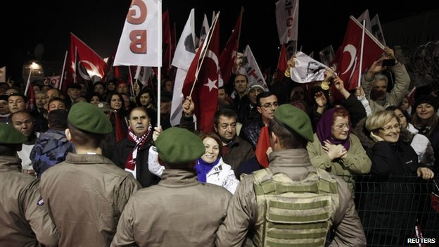 Pro-secular demonstrators wait for the release of former army chief Ilker Basbug outside the Silivri prison complex near Istanbul on 7 March 2014.