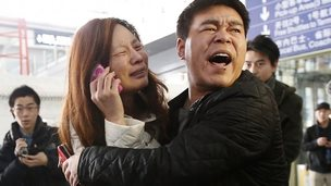 Relatives of missing passengers at Beijing airport (8 March 2014)