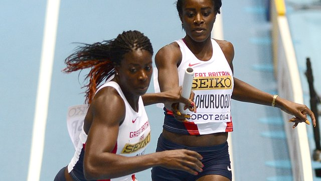 Great Britain's Christine Ohuruogu (L) receives the baton from Great Britain's Victoria Ohuruogu