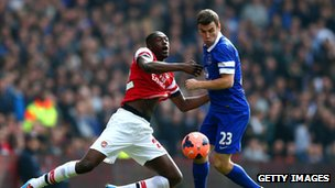 Yaya Sanogo of Arsenal and Seamus Coleman of Everton
