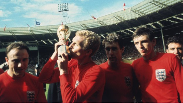 Bobby Moore kisses the Jules Rimet trophy after England beat West Germany to win the 1966 World Cup