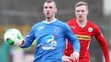 Ballinamallard's Ryan Campbell shields the ball from Cliftonville winger Chris Curran