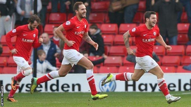 Dale Jennings celebrates scoring for Barnsley against Nottingham Forest