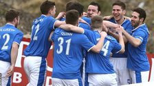 Linfield players celebrate Andrew Waterworth's opening goal