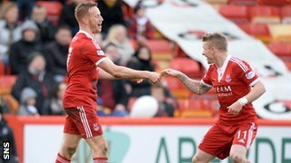 Adam Rooney (left) celebrates his goal with Jonny Hayes as Aberdeen defeat Dumbarton 1-0.