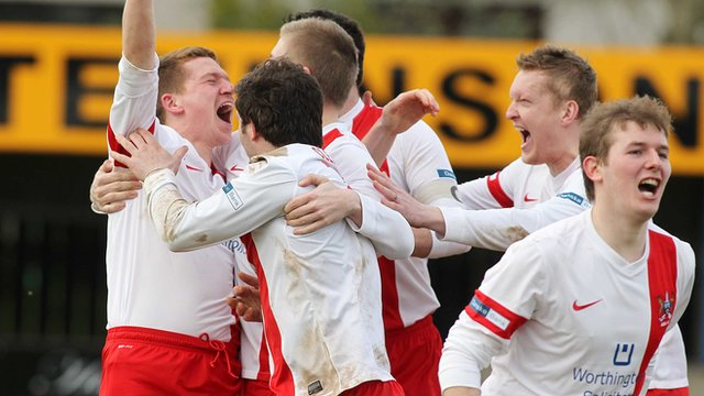 Ards players celebrate taking the lead against Warrenpoint Town