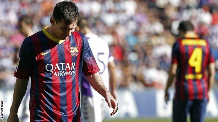Lionel Messi looks upset