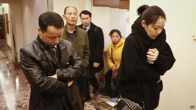 Family members arrive at a hotel which is prepared for relatives or friends of passengers aboard a missing airplane, in Beijing, China, on 9 March 2014