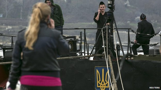 Member of Ukrainian navy talks on phone at Crimean port of Sevastopol. 8 March
