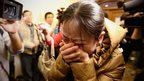 A relative of a passenger onboard Malaysia Airlines flight MH370 cries at a hotel where families are gathered in Beijing, China on 9 March 2014
