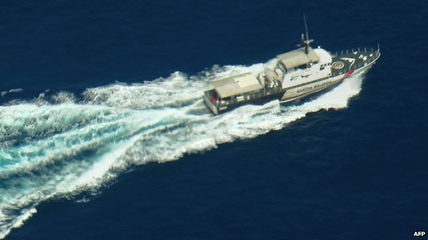 A Malaysian Maritime Enforcement boat helps in the search off north-east Malaysia, 9 March