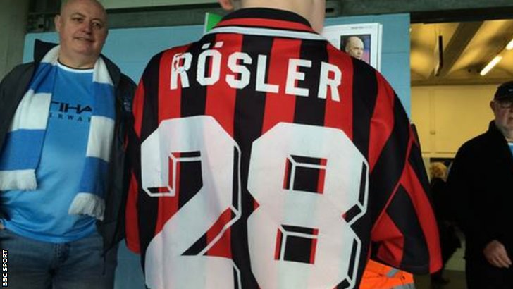 Bailey poses in his Rosler shirt