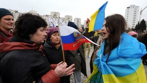 Pro-Russian and pro-Ukrainian demonstrators argue in Sevastopol