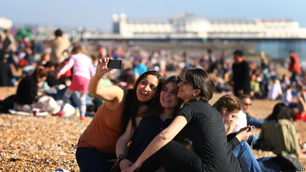 Women taking a picture in Brighton