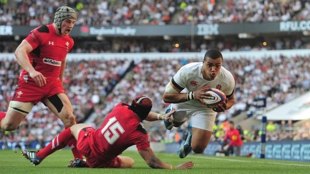 England's Luther Burrell scores a try against Wales