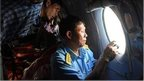 A team in a Vietnamese Air Force search aircraft, looking for missing Malaysia Airlines flight MH370
