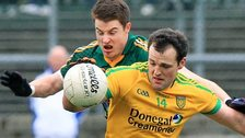 Meath's Sean Curran attempts to dispossess Donegal forward Michael Murphy