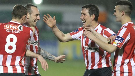 Derry goalscorer Mark Stewart is congratulated by team-mates