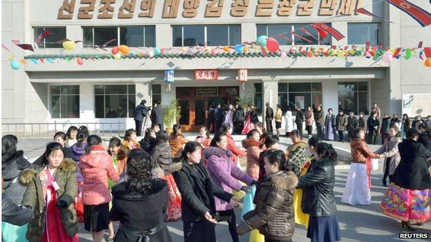 People dance to celebrate as the nation holds elections for deputies to the 13th Supreme People's Assembly