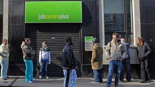 People queuing outside a job centre in Bristil
