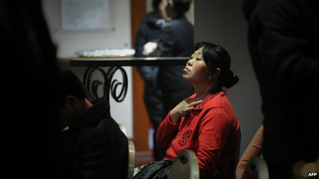 A relative of passengers from the missing Malaysia Airlines Boeing 777-200 plane waits for news at a hotel in Beijing on 11 March 2014
