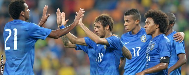 Brazilian striker Neymar celebrates scoring against South Africa