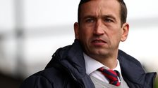 Justin Edinburgh looks on sadly.