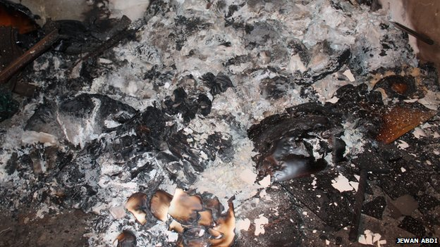 The charred remains of a stack of Korans