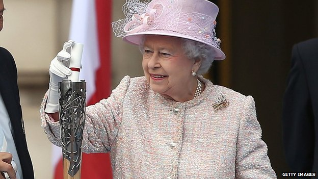 Queen Elizabeth II places her message to the Commonwealth Games in the Commonwealth Games Baton, during its launch ceremony