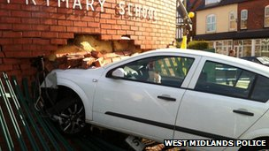Car which has crashed in to a prmiary school in Moseley