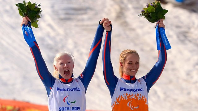 Gold medallists Kelly Gallagher (L) and guide Charlotte Evans after their women's Super-G triumph at the Paralympic Winter Games