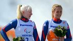 Gold medallists Kelly Gallagher (left) and guide Charlotte Evans after their women's Super-G triumph at the Paralympic Winter Games