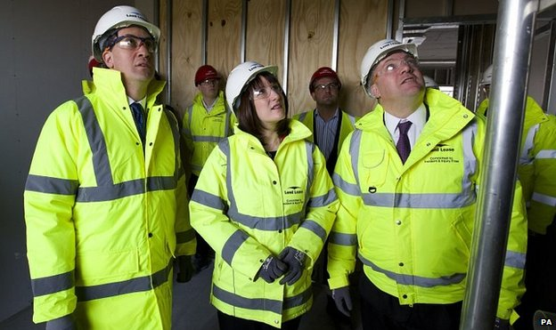 Ed Miliband (left), Rachel Reeves (centre) and Ed Balls (right) visit a building site in London
