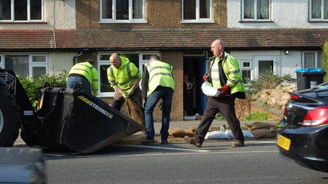 Removing sandbags in Godstone Road