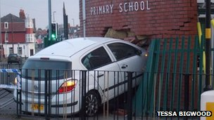 White car which crashed in to a school in Moseley
