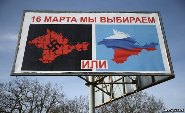 A billboard sets out the choices for the vote: Crimea with a swastika, or Crimea in Russia