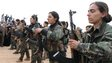 An all female military guard of honour at the funeral of a YPG fighter