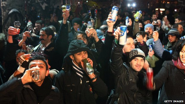 People drink beer in a square in Ankara, Turkey