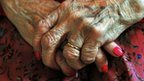 Close up on the hands of an elderly woman