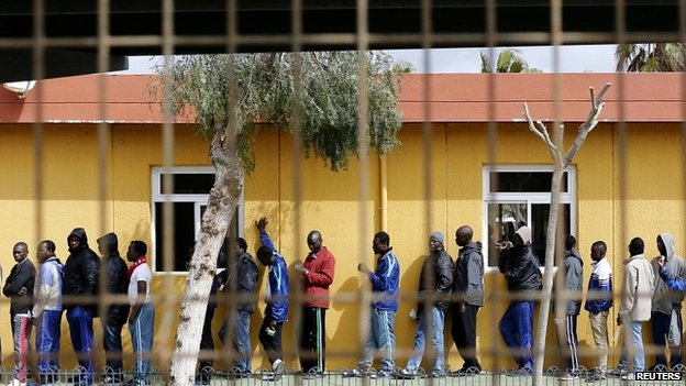 African migrants queue for lunch inside a refugee centre in the Spanish enclave of Melilla