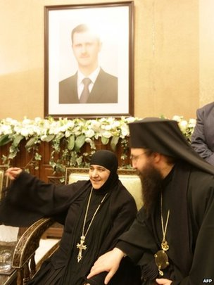Blajaa Sayyaf (L), head of the nun monastery Maaloula talks after meeting the press upon her arrival at Jdeidet Yabus on 10 March 2014.