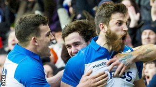 Tommy Seymour (right) celebrates his try against France