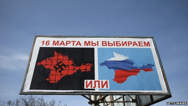 A billboard in Crimea suggests which way residents should vote in the 16 March referendum