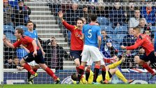 Ciaran Donnelly (left) wheels away in delight after putting Albion Rovers ahead against Rangers