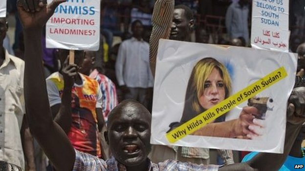 A South Sudanese protester shouts slogans while holding a placard with a photo montage of UN special representative Hilda Johnson holding a handgun, during a rally in Juba on 10 March 2014